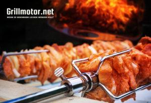 Grillmotor für Grillspieße auf Holzkohlegrill